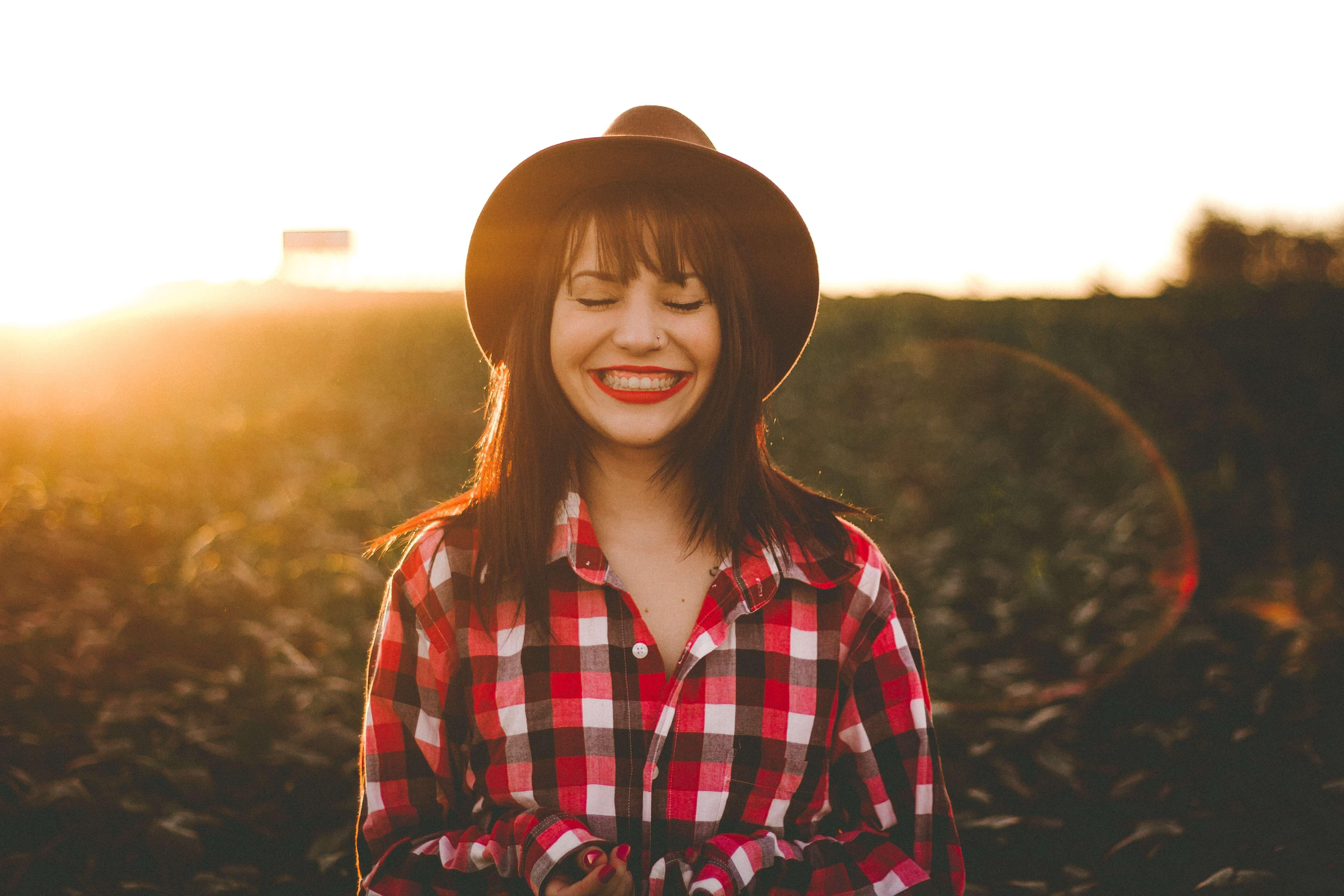 Happy women smiling wearing brown hat