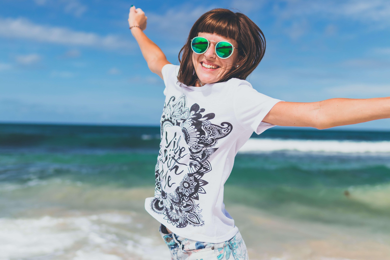 Women jumping with joy on beach